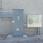 Electric service installation with exterior disconnect